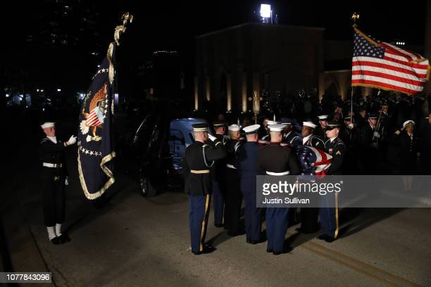 Military honor guard carries the flagdraped casket of former US President George HW Bush into St Martin's Episcopal Church on December 5 2018 in...