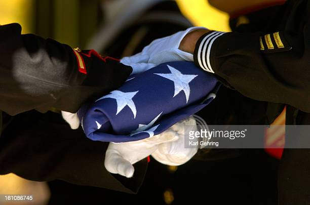 MILAMFUNERAL A military honor guard folded an American flag after it was removed from the casket of Navy corpsman Luke Milam following a funeral...