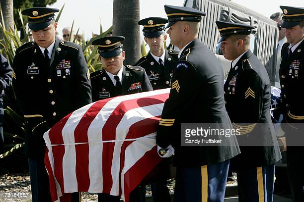 Military Honor Guard members carry a coffing with Capt Brian Freeman during a memorial service at Ft Rosecrans National Cemetery on February 2 2007...