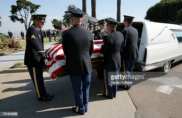 Military Honor Guard members take out the coffin with Capt Brian Freeman during a memorial service at Ft Rosecrans National Cemetery on February 2...