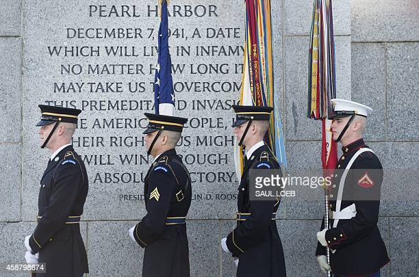 A military honor guard prepares to advance the colors during a Veterans Day ceremony at the World War II Memorial on the National Mall in Washington...