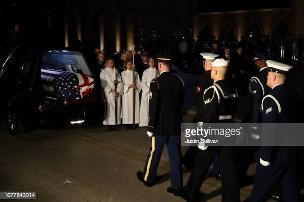 Military honor guard prepares to carry the flagdraped casket of former US President George HW Bush into St Martin's Episcopal Church on December 5...