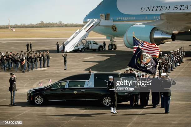 A military honor guard removes the remains of President George HW Bush from a hearse before carrying them to Special Air Mission 41 for a flight to...