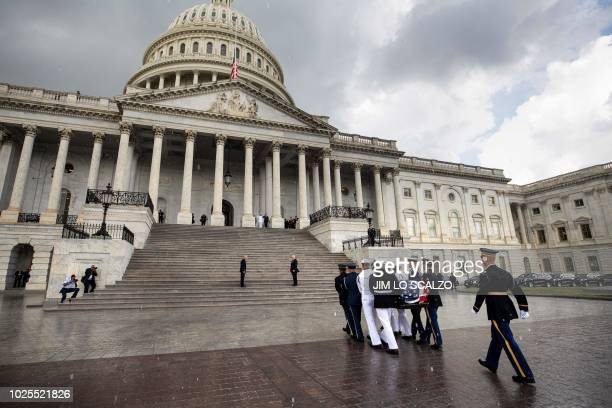 A military honor guard team carries the flagdraped casket of the late US Senator John McCain Republican of Arizona at the US Capitol in Washington DC...