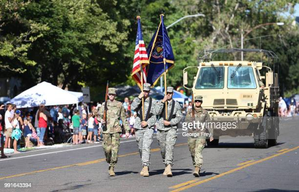 A military honor guard walks down the street to open the Provo Freedom Festival Parade on July 4 2018 in Provo Utah This is one of the largest...
