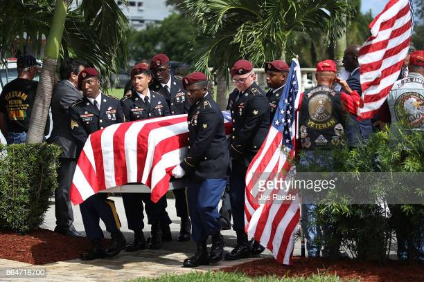 S Military honor guards carry the casket of US Army Sgt La David Johnson during his burial service at the Memorial Gardens East cemetery on October...