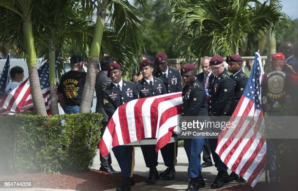 US Military honor guards escorts the casket of US Army Sgt La David Johnson during his burial service at the Memorial Gardens East cemetery on...