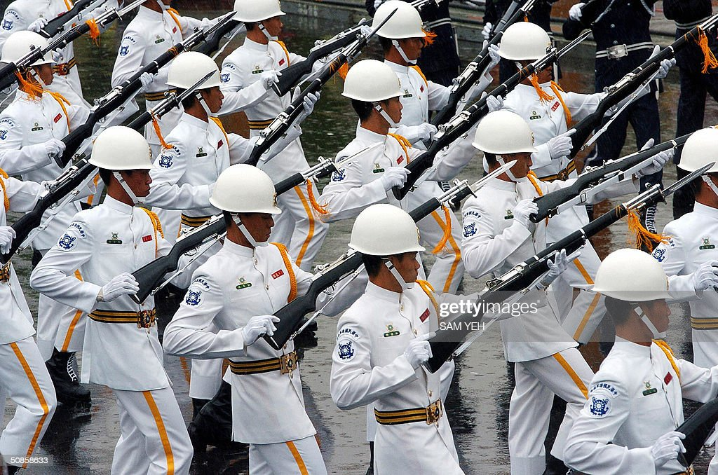 Military Honor Guards perform during the inauguration ceremony in front of Presidential Palace in Taipei 20 May 2004. Taiwan's President Chen Shui-bian refused to rule out eventual reunification with China, after Beijing threatened to crush any moves by the island towards independence. AFP PHOTO/Sam YEH