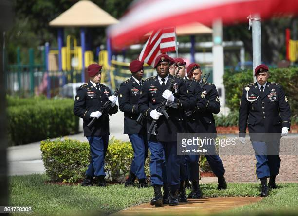 S Military honor guards prepare for the 21 gun salute for US Army Sgt La David Johnson during his burial service at the Memorial Gardens East...