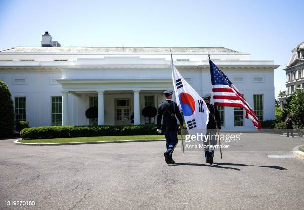 Military honor guardsmen get in place before the arrival of Korean President Moon Jae-in at the White House on May 21, 2021 in Washington, DC. Moon...