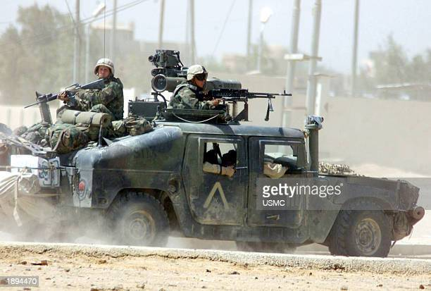Military Humvee with a .50 caliber machine gun attached races toward a firefight April 1, 2003 in An Nasiriyah, Iraq. Coalition forces are inching...