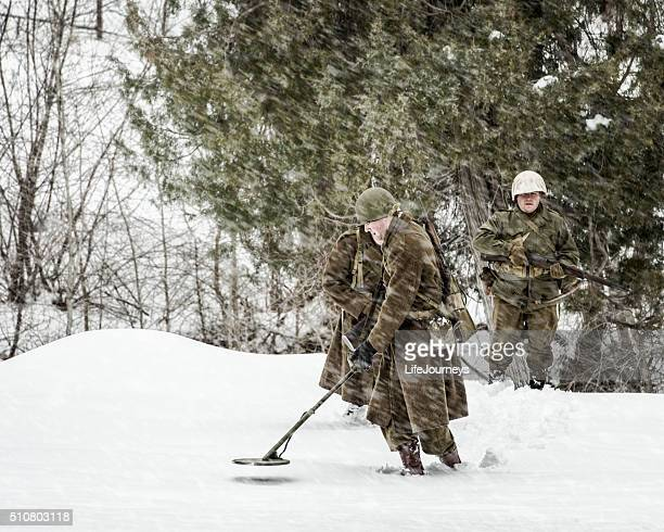 wwii us military infantry soldiers sweeping for mines - booby trap stock pictures, royalty-free photos & images
