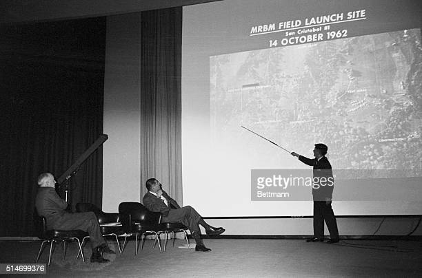 Military intelligence consultant John P Hughes explains an aerial surveillance photo of a Soviet built MRBM missile launching site at San Cristobal...