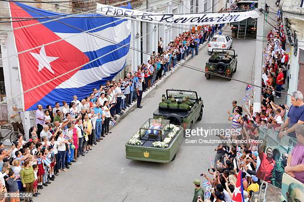 A military jeep pulls a trailer with the flag draped chest containing the remains of former President Fidel Castro on the second day of a 4 day...
