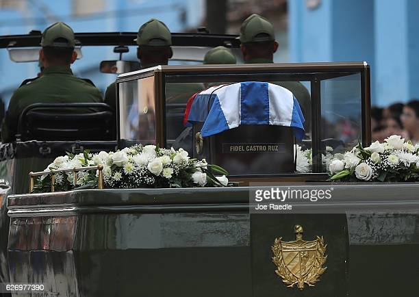 A military jeep tows a trailer with the flag draped chest containing the remains of former President of Cuba Fidel Castro during a journey across the...
