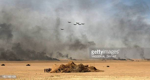 Military jet fighter take part in a military exercise at Udaira military range 140 km North of Kuwait City on February 26 as part of joint GCC...