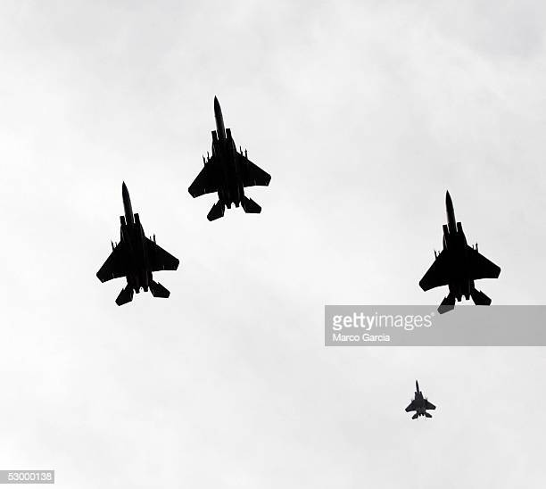 S Military jets fly in a ceremonial missing man formation over the National Memorial Cemetery of the Pacific May 30 2005 in Honolulu Hawaii