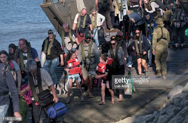 Military landing craft arrives with CFA members and evacuees on January 8 2020 in Hastings Australia The 205 people are returning to Melbourne after...