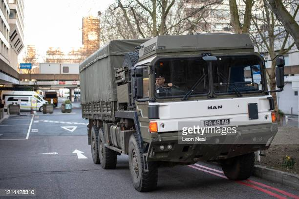 A military lorry is seen as members of the 101 Logistic Brigade of the British Army deliver a consignment of medical masks to St Thomas' hospital on...