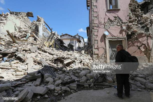 A military man near the rubble of a house completely collapsed after the earthquake that hit the city of Amatrice in central Italy