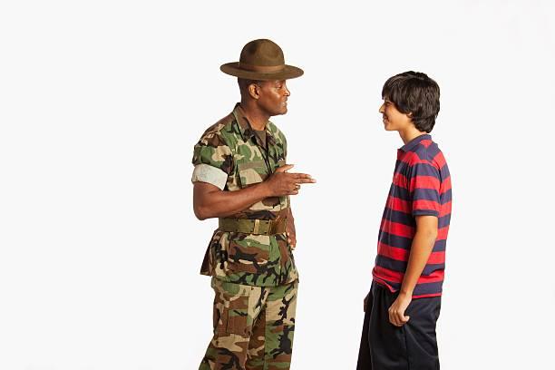 A Military Man Talking To A Teenage Boy