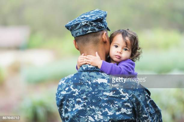 us military man with baby girl - navy stock pictures, royalty-free photos & images