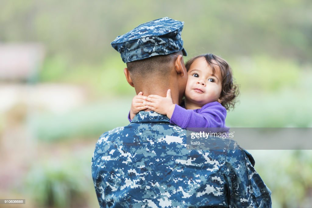 US military man with baby girl : Stock Photo