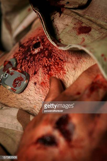 military man with high caliber gun shot wound left chest - burn injury stock photos and pictures