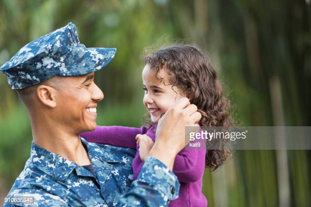US military man with young daughter