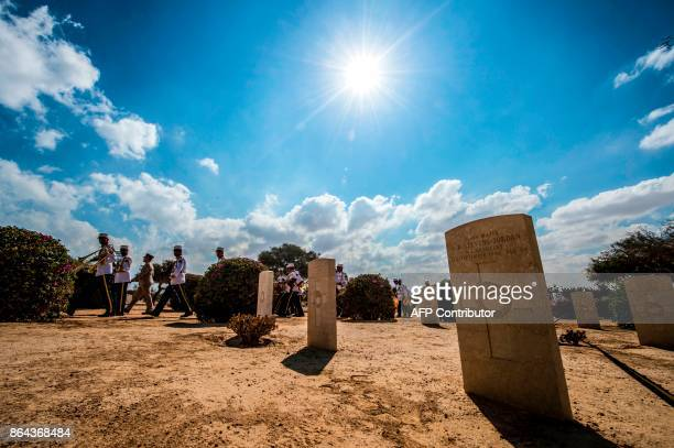 A military marching band passes by the Allied graves at El Alamein War Cemetary during a ceremony marking 75 years since the pivotal WWII battle in...