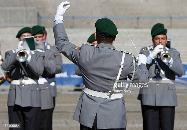 A military marching band performs prior to a swearingin ceremony for new recruits of the Bundeswehr the armed forces of the Federal Republic of...