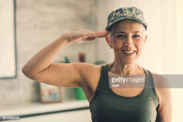 military mature woman saluting - saluting stock pictures, royalty-free photos & images