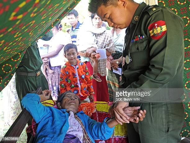 A military medical officer examins a victim of the recent earthquake at a temperory relief camp in Thabeik Kyin township Mandalay a division in...