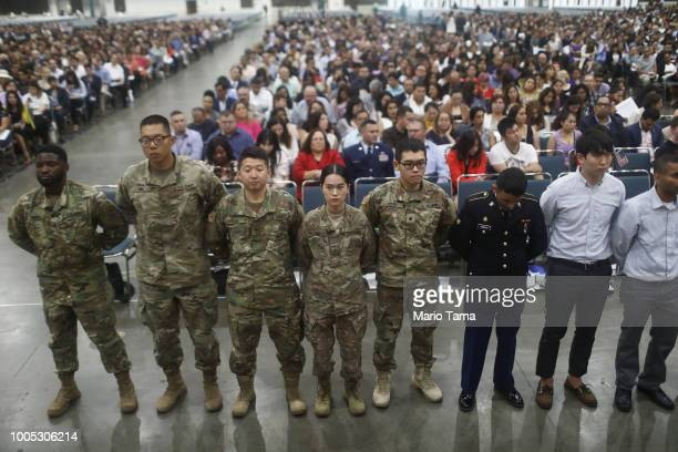 S military members stand after becoming US citizens at a naturalization ceremony on July 25 2018 in Los Angeles California Two naturalization...