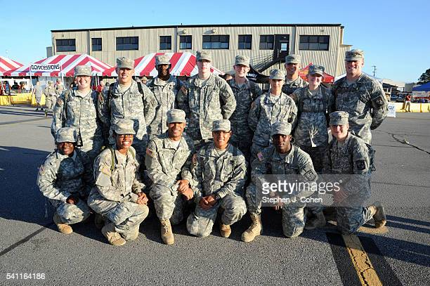 Military men and women attend the 2016 Fort Knox Army Birthday Summer Concert at Fort Knox Godman Airfield on June 18 2016 in Fort Knox Kentucky