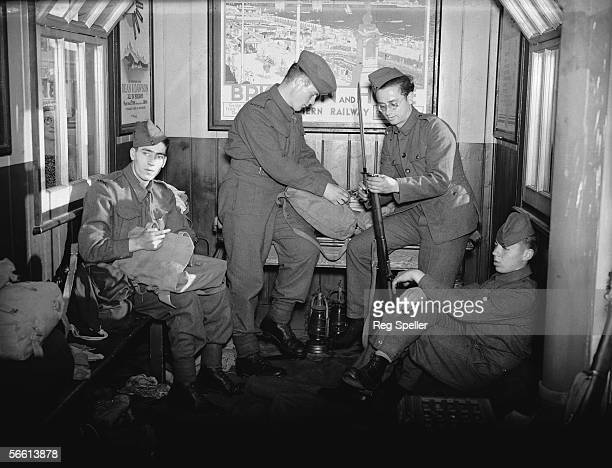 Military men using a London railway station as a guard room during World War II, 29th August 1939.
