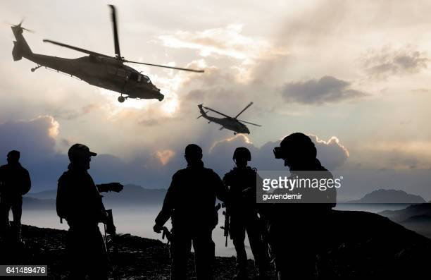 military mission at dusk - helicopter photos stock pictures, royalty-free photos & images