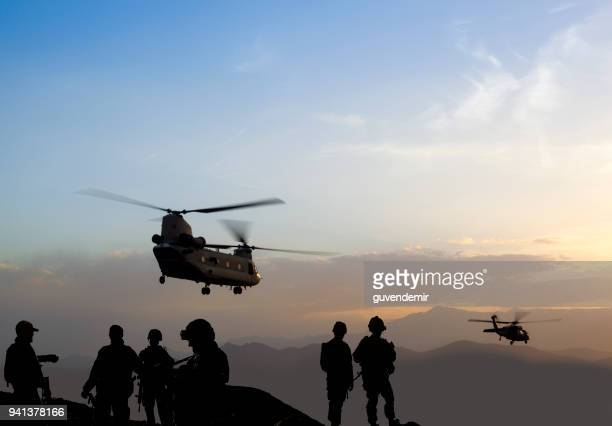military mission at dusk - army soldier stock photos and pictures