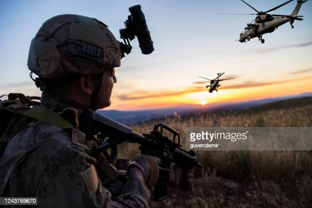 military mission at sunrise - apache helicopter stock pictures, royalty-free photos & images