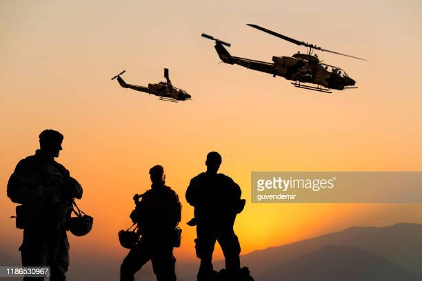 military mission at sunset - special forces stock pictures, royalty-free photos & images