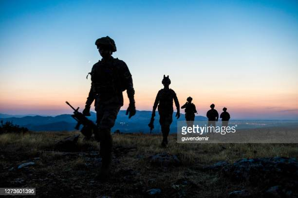 military mission at twilight - military invasion stock pictures, royalty-free photos & images