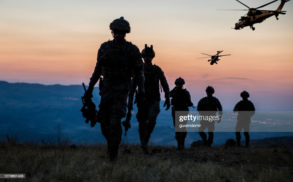 Military Mission at twilight : Stock Photo