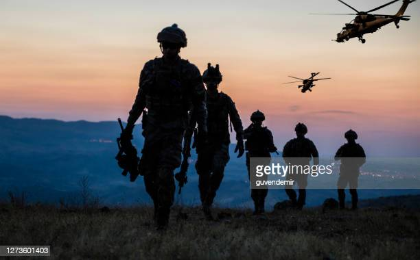 military mission at twilight - army soldier stock pictures, royalty-free photos & images