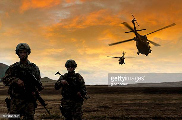 military mission on sunset - army soldier stock photos and pictures