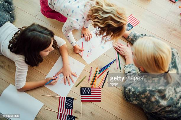 Military Mom Coloring With Her Kids.