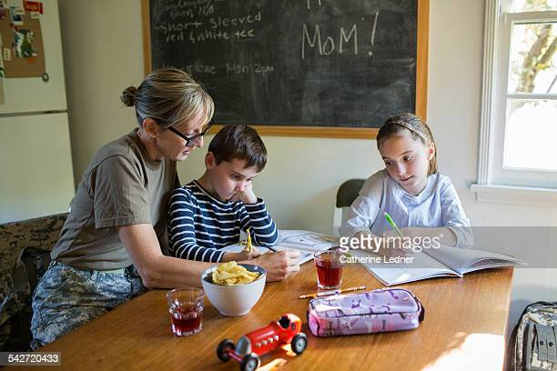 Military Mom helping her Children with Homework
