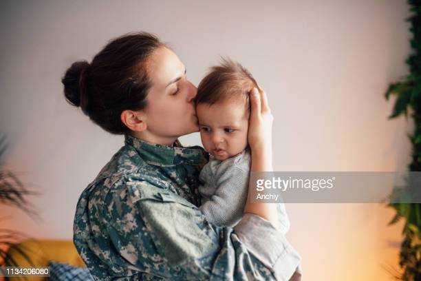 Military Mom Kissing Her Baby Son