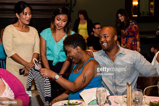 Military motherstobe receive gifts during the 'Hello Sunshine' Operation Shower event before the Webcom Tour Championship at TPC Sawgrass Dye's...