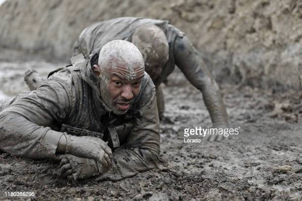 military mud run crawling exercise - military training stock pictures, royalty-free photos & images
