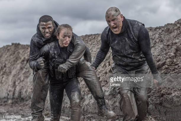military mud run group - life in the trenches stock pictures, royalty-free photos & images